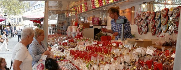 A vendor selling various sweets during the celebration of the Octave